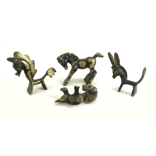 89 - A group of Austrian bronze animal figures, comprising a donkey, a dog, and two horses, mid 20th cent...