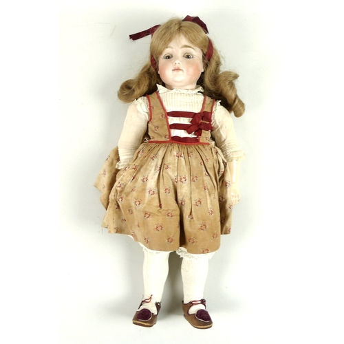 108A - A collection of three late 19th century / early 20th century and later dolls, comprising a bisque he...