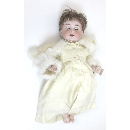 107 - A Jutta baby doll, circa 1922, with sleeping eyes, open mouth, and a swans down hood, 55cm....
