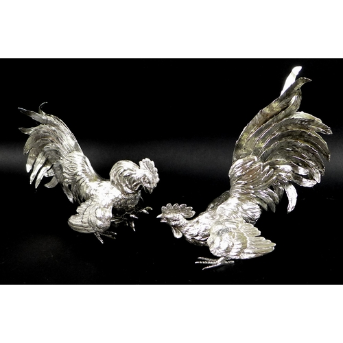 1 - A pair of silver fighting cockerels, each cast with feathered detailing, London import mark, 1957, J...