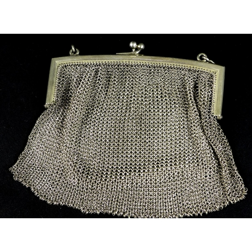 19 - A silver mesh evening purse, London import 1912, Paul Ettlinger, 4.5toz, together with a black lacqu...