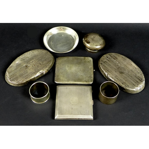 28 - A group of silver, comprising an engine turned cigarette case, Birmingham 1924, Henry Matthews, a se...