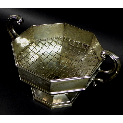 38 - An Edward VIII silver octagonal twin handled trophy, flying scroll handles, stepped octagonal base, ...