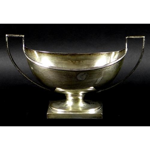 63 - A Victorian silver twin handled boat shaped pedestal dish, angular twin handles, London 1895, Charle...