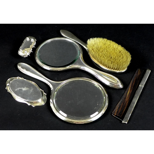 52 - A selection of silver and silver backed dressing table items, comprising a silver backed hairbrush, ...