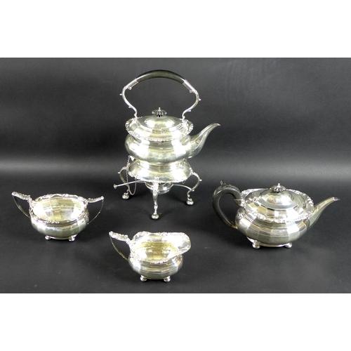 78 - A George V four piece silver tea set comprising tea pot, milk jug, sucrier and spirit kettle on stan...
