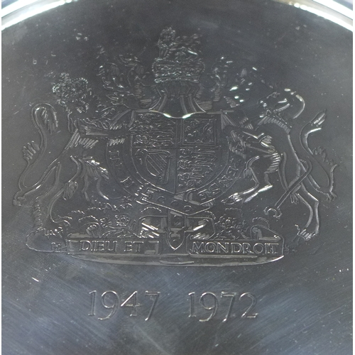 4 - An Elizabeth II silver salver commemorating her Silver Wedding, engraved with the Royal Coat of Arms...