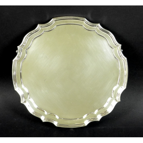 27 - An Elizabeth II silver salver with pie crust rim, plain body, Sheffield 1967, BD, 20.5cm, 9.51toz....