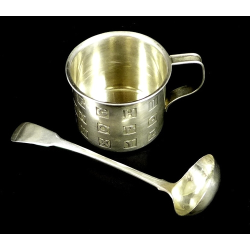 8 - A Cartier silver christening cup, of small can form with alphabet design, marked to the base Cartier...