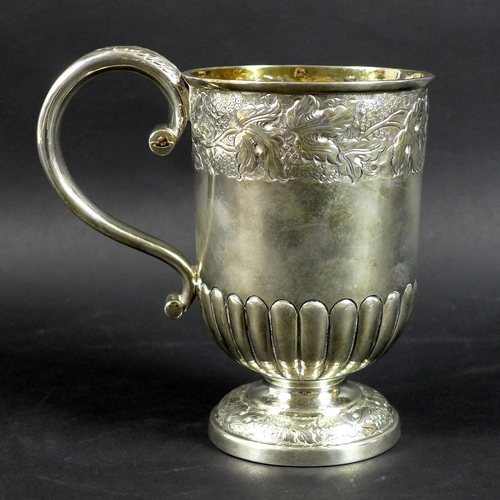 54 - A large George VI silver christening cup, the body and foot chased and embossed with bands of traili...