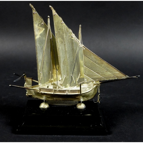 13 - A Maltese silver model of a boat or Dghajsa, hallmarked to skeg beneath the keel, on ebonised plinth...