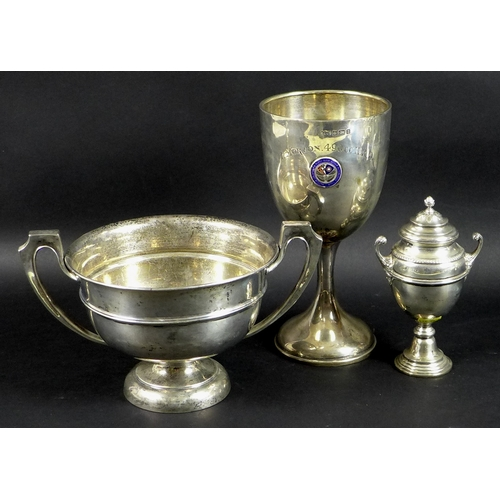 33 - A group of three Edwardian silver sporting trophies awarded to Tom Morton, comprising a twin handled...