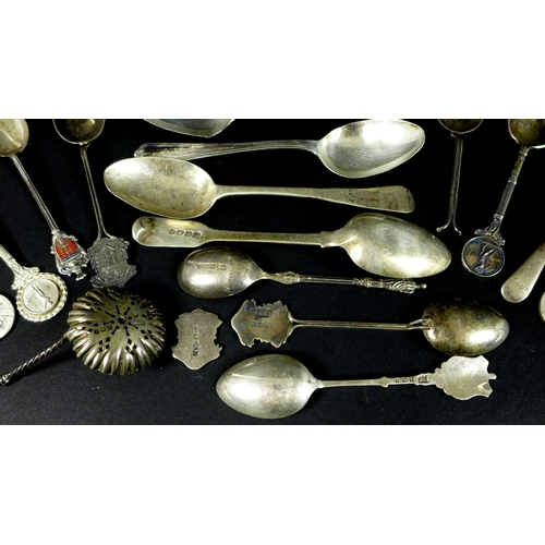 61 - A group of silver spoons and teaspoons, including three George IV fiddle pattern dessert spoons, Lon...
