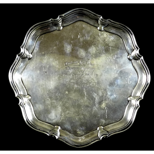 46 - A George V silver salver presented by Birkdale Golf Club, with pie crust edge, raised on four legs, ...