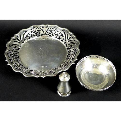 56 - A group of Victorian and later silver, comprising a salver with pierced rim, monogram engraved, rais...