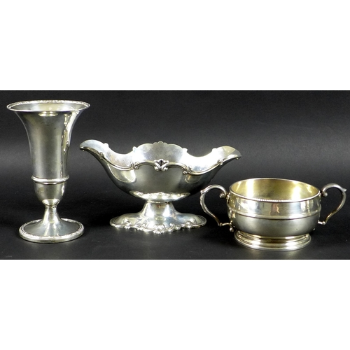 49 - A group of Edwardian and later silver, comprising a Rococo style sauce boat on stand, London 1905, H...