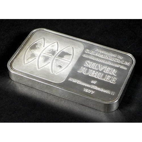6 - A half kilo 999 silver ingot, made to commemorate the Queen's Silver Jubilee presented by C E Heath ...