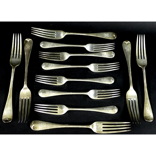 50 - A set of six Edward VII silver table forks and six dessert forks, Old English pattern, terminals eng...