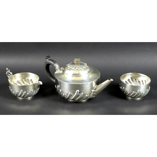 74 - A Victorian three piece silver tea set comprising teapot, milk jug and sugar bowl, all chased and em...