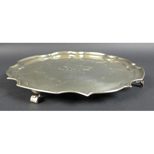47 - A silver salver with pie crust rim, the body with central inscription engraved 'To Captain and Mrs B...
