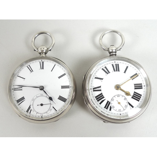 21 - Two silver pocket watches, both with white enamel dials with Roman numerals and subsidiary seconds d...