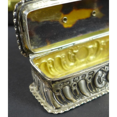 57 - A Victorian silver snuff box with tortoiseshell lid, the silver sides chased and embossed with scrol...