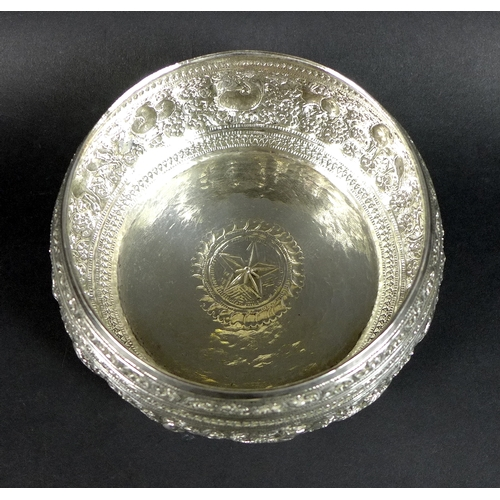 26 - A group of vintage Thai silver, comprising a set of four graduated bowls, the repoussé worked bodies...
