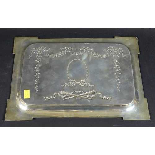 53 - A George V rectangular silver tray, the body decorated with floral swags, bows, ribbons and torches,...