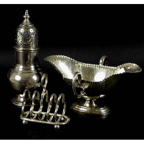 65 - A group of three Victorian and Edwardian silver items, comprising a sugar castor, Pairpoint Brothers...