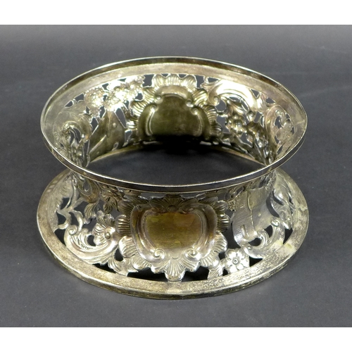 70 - An Irish late Victorian silver potato ring, decorated with a woodland frieze with a grazing deer, a ...