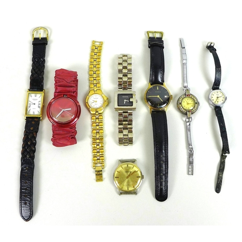 112 - A group of eight watches, including a Raymond Weil rectangular faced watch with Roman numerals, a Gu...