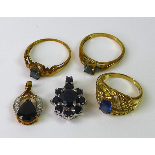 153 - A group of 9ct gold jewellery, comprising a sapphire pendant, a sapphire and diamond dress ring, siz...