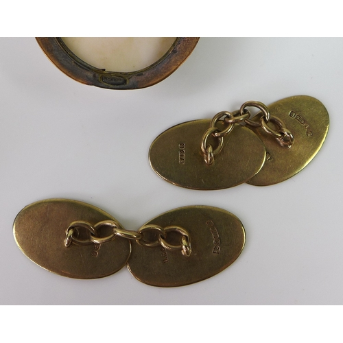 128 - A vintage cameo brooch set in a 9ct gold surround, 10.6g, together with a pair of 9ct gold cufflinks...