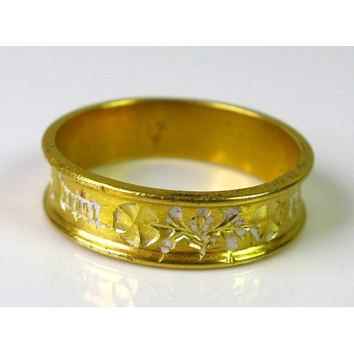 257 - A late Medieval gold sweetheart or posy ring, possibly Norman, engraved with flowers amidst inscript...