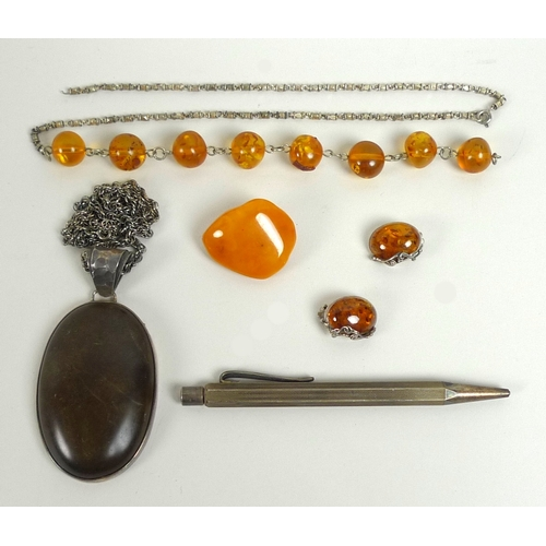 113 - A collection of silver and amber jewellery, comprising a vintage butterscotch coloured brooch, a dar...