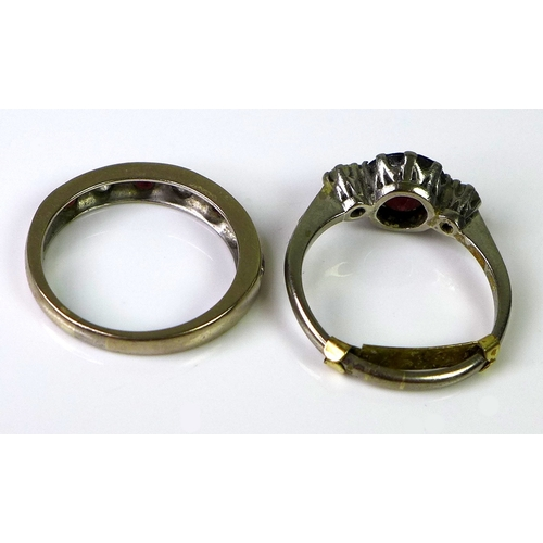 201 - A 9ct white gold ring set with central large garnet flanked by two diamonds, approx 0.15cts total di...