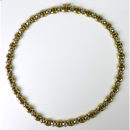 110 - A 9ct gold necklace formed of yellow gold ovals interspersed with white gold spacers, clasp marked 3...