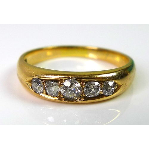 204 - An 18ct gold ring set with five diamonds, approx 0.3cts total diamond weight, 3.8g....