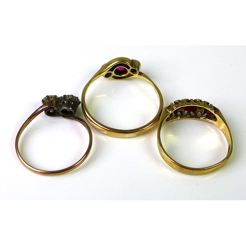 155 - A group of three rings, one a late 19th or early 20th century three stone ring, central pink stone, ...