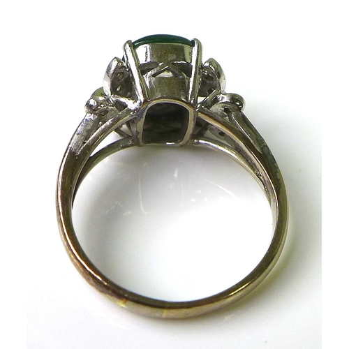 126 - A vintage 1970's 18ct white gold, diamond and jade dress ring, with central jade cabouchon of approx...