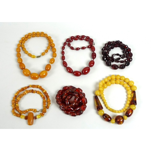 139 - A collection of vintage amber coloured bead necklaces, bakelite and plastic, various hues including ...
