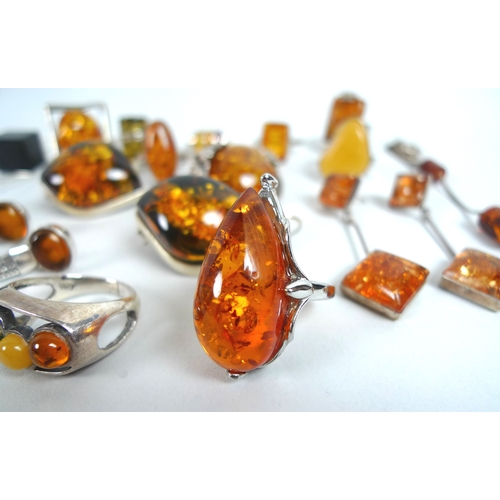 125 - A collection of amber and amber coloured jewellery, all set in white metal or silver, some pieces ma...
