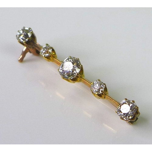 241 - A five stone diamond set yellow metal bar brooch, the central diamond approx 0.5ct, the two end diam...