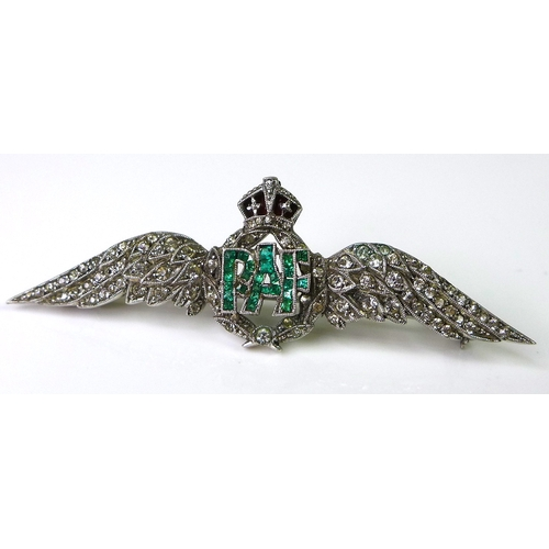 231 - An 18ct white gold RAF dress brooch set with diamonds and emeralds, two diamond encrusted wings flan...