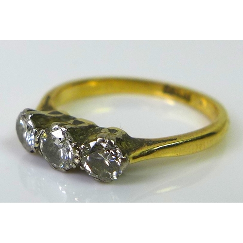 216 - An 18ct gold three stone diamond ring, approx 0.5ct total diamond weight, size K, 2.4g.