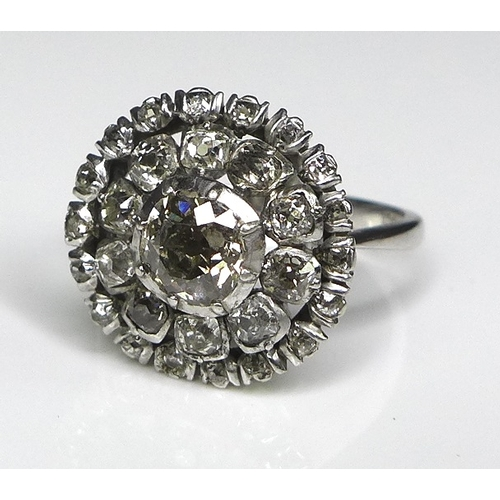 245 - A 19th century and later diamond flowerhead ring, the central old cut diamond approx 1ct, 6mm across...