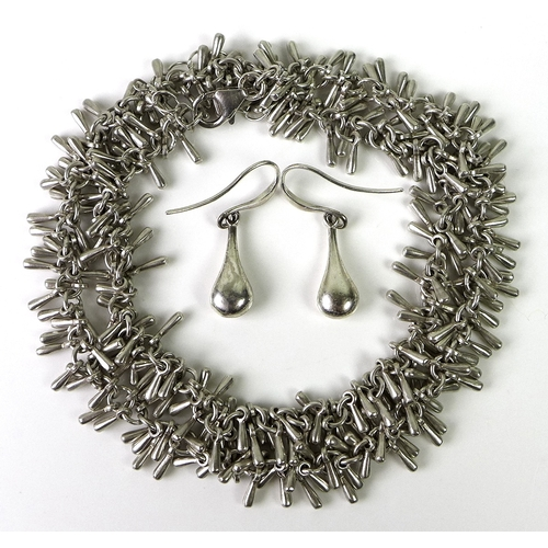 122 - A silver fringe form necklace, 39.7g, together with a pair of white metal drop earrings by Pilgrim. ...