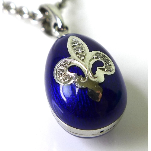 253 - A Victor Mayer for Faberge 18ct white gold egg pendant, blue guilloche enamelled and set with 0.05ct...