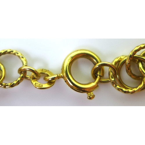 260 - A Kutchinsky 18ct gold chain link necklace, formed of interconnected plain and fine rope twist rings...