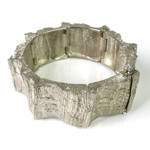 151 - A Danish silver cuff bangle formed of eight connected panels with bark texturing, marked Anton Miche...